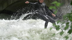 Surfing and swimming in the Isar River, Munich Stock Footage