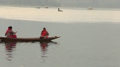 People in boat for transportation in lake. Srinagar, Jammu and Kashmir, India Stock Footage