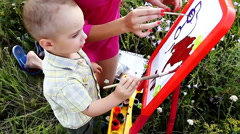 Stock Video Footage of Happy mother and son paint colors in nature