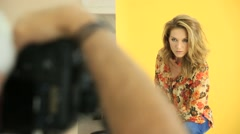 Woman model being photographed in studio Stock Footage