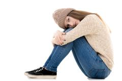 Lonely teenage girl with bored look Stock Photos