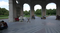 Playing the piano under the Temple of Diana in Munich Stock Footage
