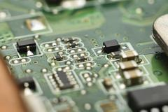 micro electronics main board with processors, diodes, transistors - stock photo