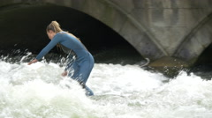 Girl surfing on Isar River in Munich - stock footage