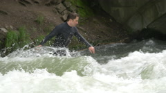One man surfing on Isar River in Munich Stock Footage