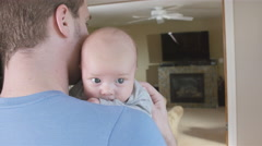 Newborn Baby boy on father's shoulder - stock footage