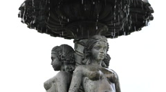 Stock Video Footage of Fountain water flowing over  topless woman shape statues, urban art
