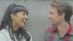 4K Portrait of attractive smiling couple in urban environment. Stock Footage