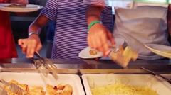 Hands of people taking meal in public canteen in hotel Stock Footage