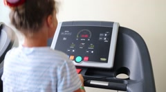 Girl trains on treadmill in fitness center. Stock Footage