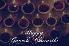 celebrating ganesh chaturthi with oil lamps, retro effect - stock photo