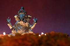 Ganesh idol shining due to oil lamp, festival season - stock photo
