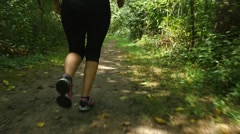 Woman trail running Stock Footage