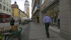 Theatinerstrasse with shops and restaurants in Munich Stock Footage