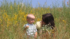 Pure love, baby boy kissing young mother in nature, happy, smiling family Stock Footage