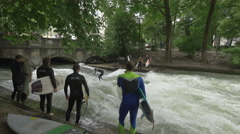 Group of surfers surfing in Munich Stock Footage