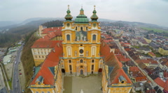 Flyover view of famous Baroque-style abbey in Melk, Austria. Inner yards visible Stock Footage