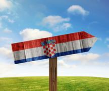 Croatia wooden direction sign on nature background - stock illustration
