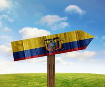Ecuador wooden direction sign on nature background - stock illustration