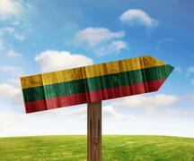 Lithuania wooden direction sign on nature background - stock illustration