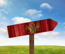 Montenegro wooden direction sign on nature background - stock illustration