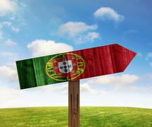 Portugal wooden direction sign on nature background - stock illustration