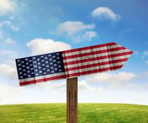 US wooden direction sign on nature background - stock illustration
