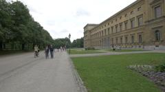 Walking near the Munich Residenz in Hofgarten Stock Footage