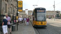 Tram stop next to Theaterplatz in Dresden, Germany. City life. - stock footage