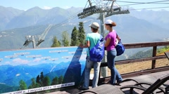 Woman and boy on viewing platform of Mountain Carousel Stock Footage