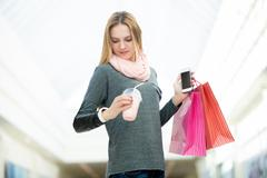 Hustle, busy life. Young woman in a hurry, waiting, checking time on her wris Stock Photos