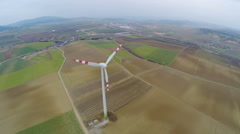 Panorama of wind turbine on green field in countryside. Energy self-sufficiency Stock Footage