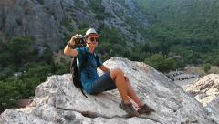 Young man doing the selfie in the mountains Stock Footage