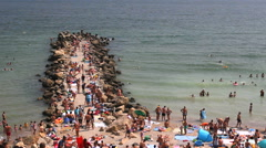 Stock Video Footage of Crowed beach coast, summer holiday