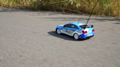 Stock Video Footage of Radio controlled car Chevrolet on road in Moscow.