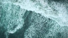 Aerial shot of rolling ocean waves - stock footage