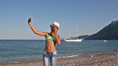 Young girl making  selfie on the beach of the Mediterranean Sea Stock Footage