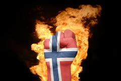 fire fist with the national flag of norway - stock photo