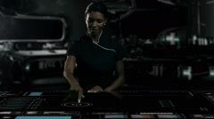 African American female using table touchscreen technology in futuristic office Stock Footage
