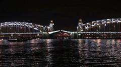 Timelapse of opening the Bolsheokhtinsky bascule bridge at night on Neva river Stock Footage