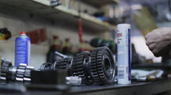 Car mechanic lubricate the transmission mechanism in the garage Stock Footage