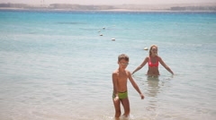 Mother and son out of the red sea Stock Footage