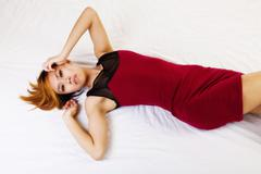 Skinny Asian American Reclining On Floor Red Dress - stock photo
