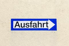 Stock Photo of sign exit in german painted at a wall