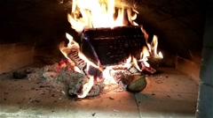 Burning firewood in a wooden heated oven Stock Footage