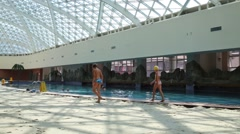 Boy and girl go near pool in Gorky Gorod Mall (models with releases) Stock Footage