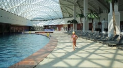 Girl runs near pool in Gorky Gorod Mall (model with release) Stock Footage