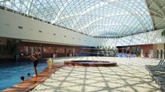 People rest in pool in Gorky Gorod Mall in Krasnaya Polyana Stock Footage