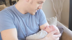 Father soothing a crying newborn - stock footage