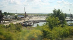 Industrial zone with dock at summer. View from moving train Stock Footage